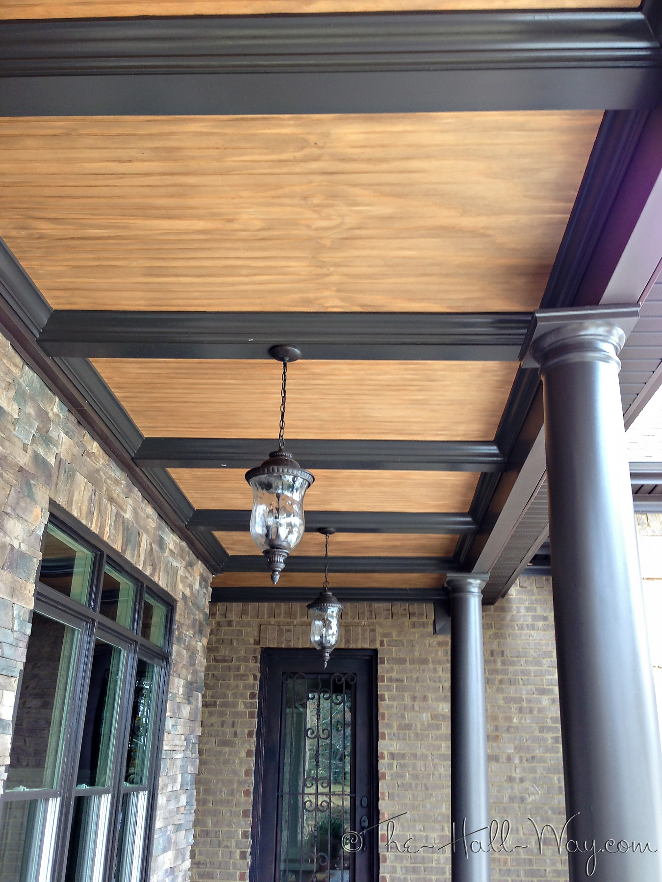Brick and stone the hall way for Balcony ceiling design