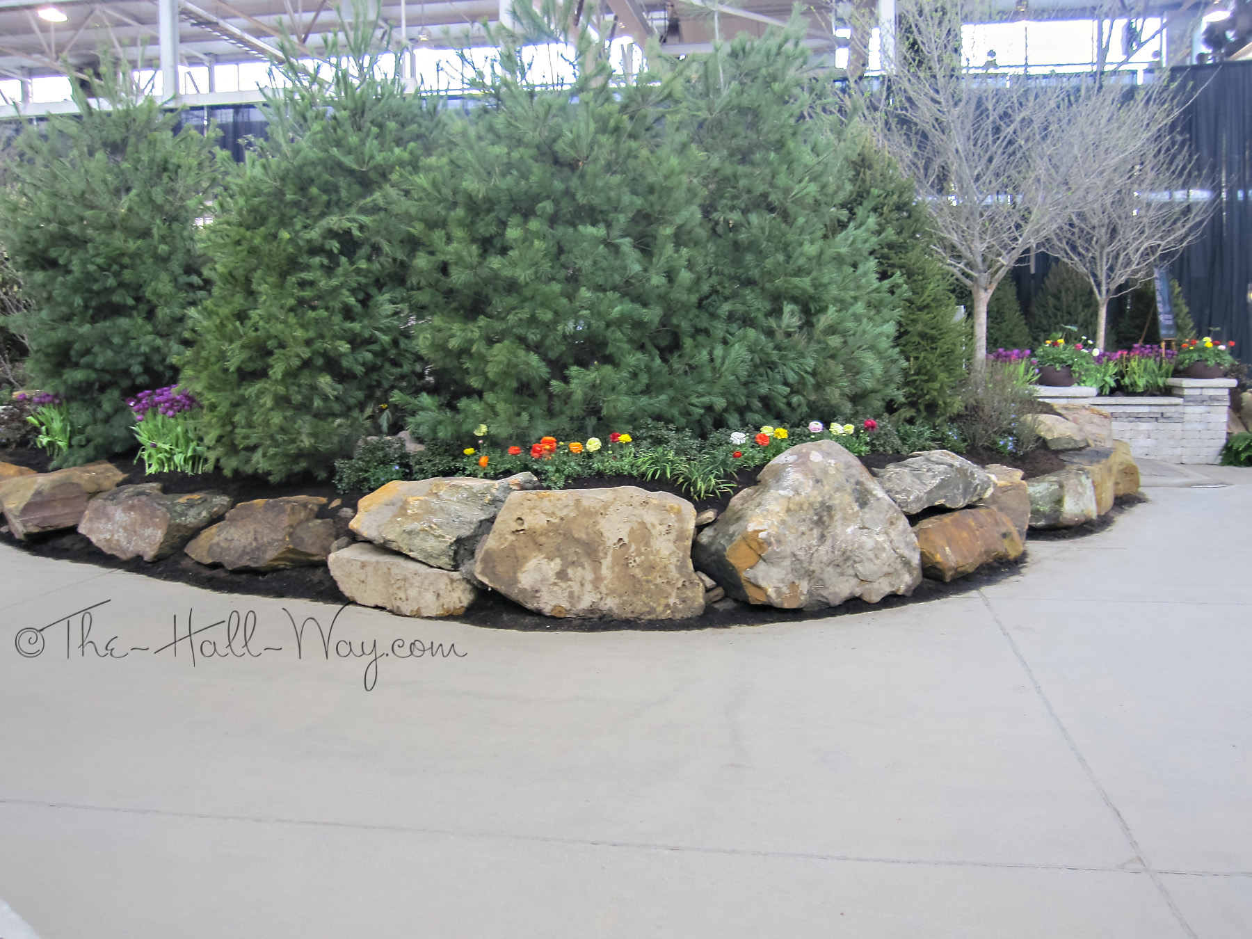 Indy garden show the hall way for Garden designs with rocks